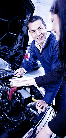 Mechanic Discussing With Client